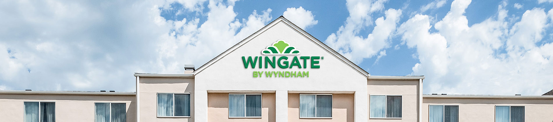 Exterior of the Wingate Minot with the sign visible